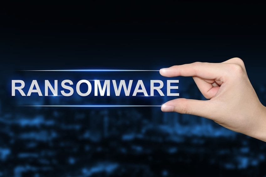 hand clicking ransomware button